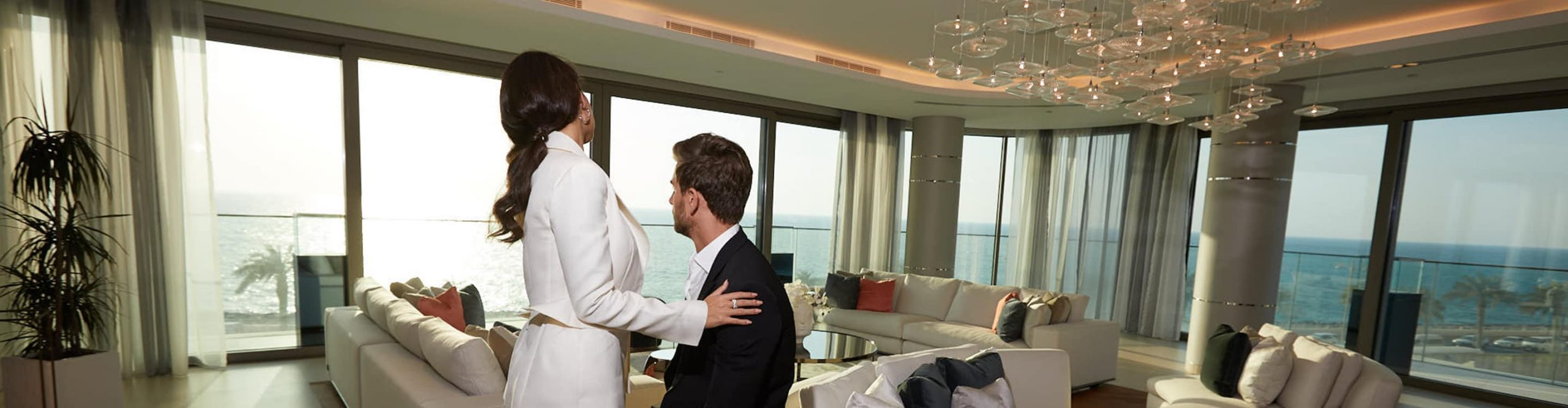 A young couple enjoy life in their luxury apartment in Dubai