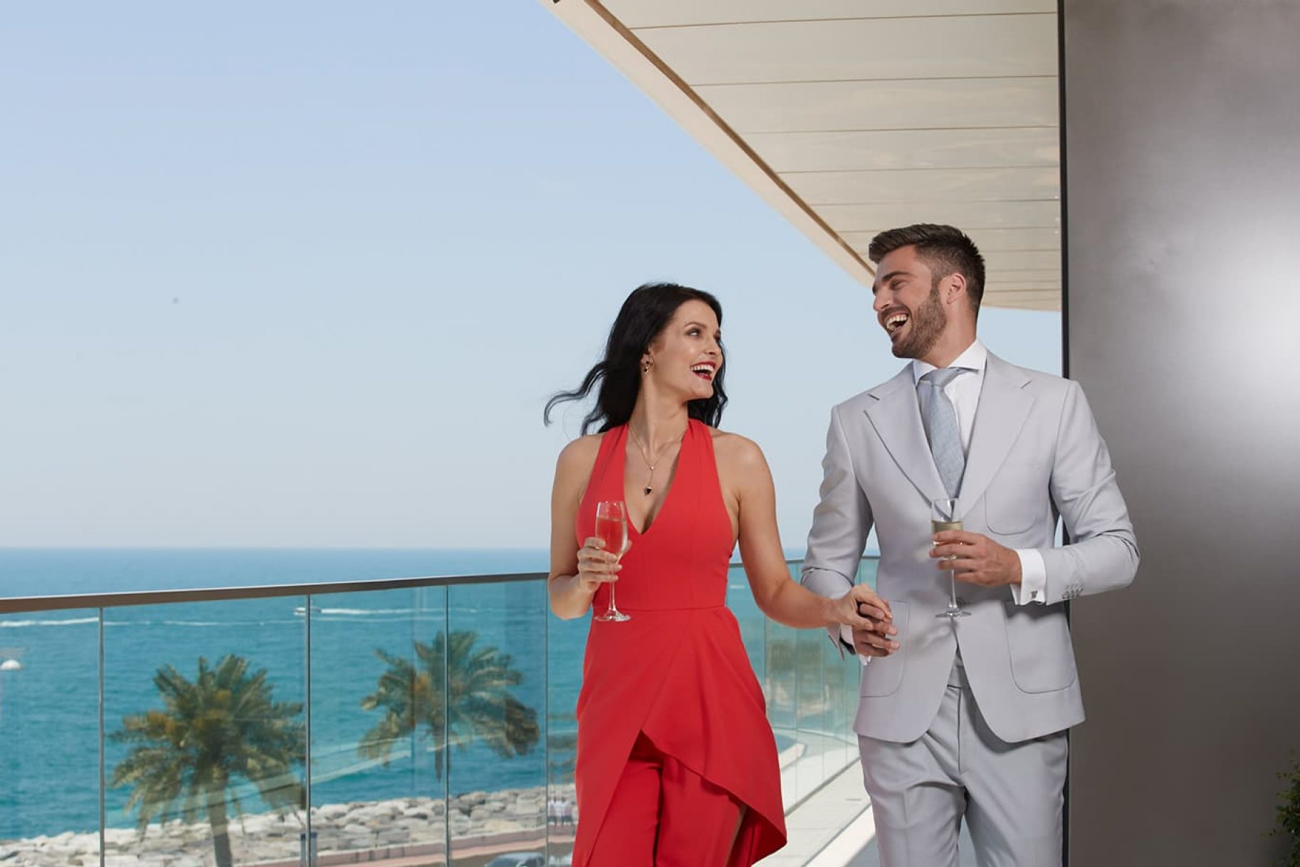 A young couple on the balcony of a luxury apartment