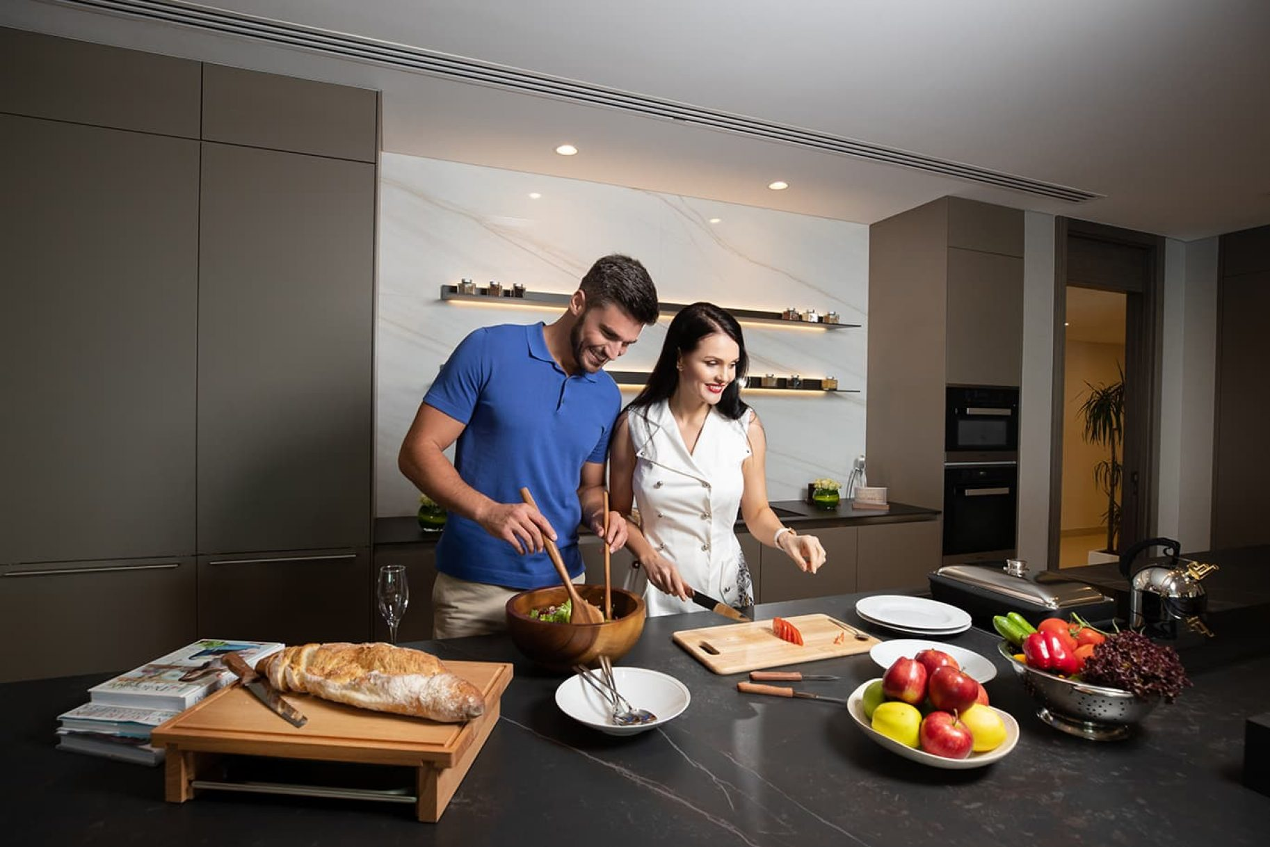 A couple cook in their luxury kitchen