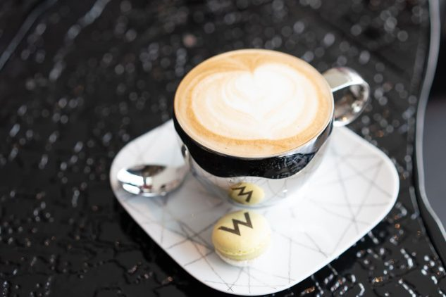 A coffee with branded W macaroon