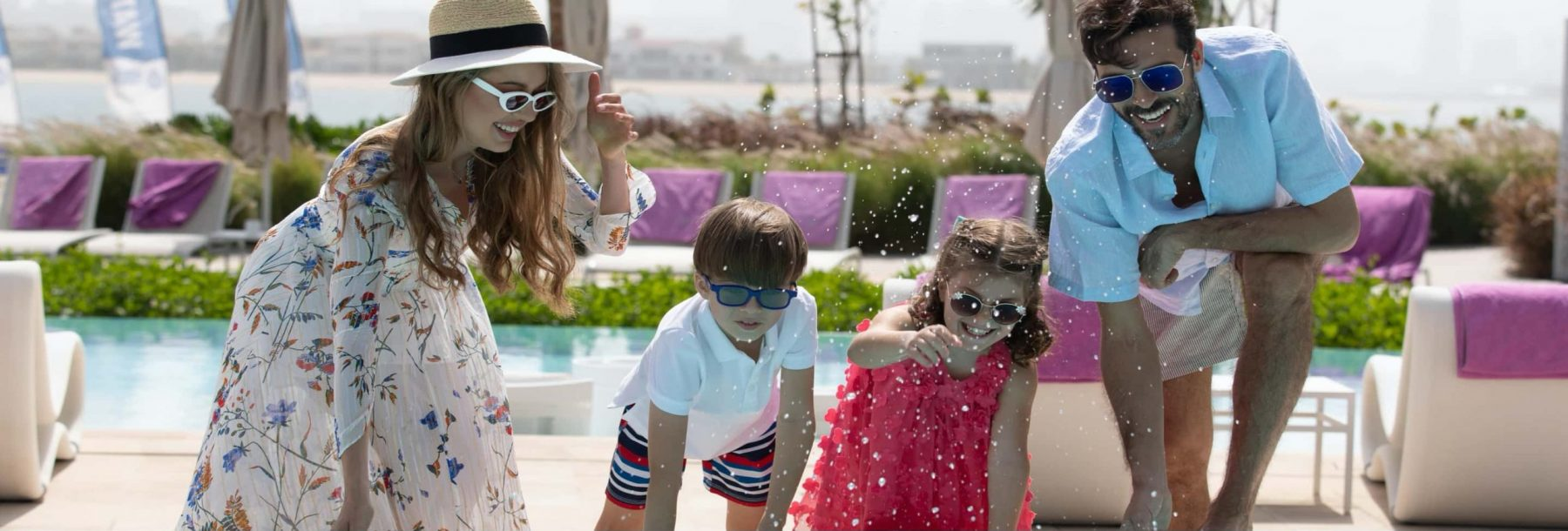 A young family enjoy life in a sunny waterfront apartment complex