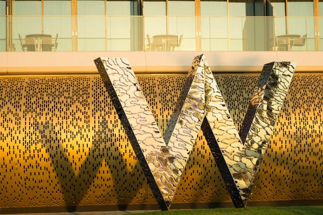 A large gold W - logo of W Hotels