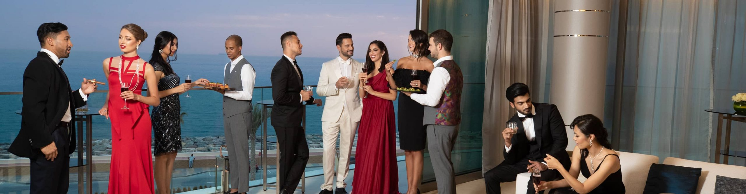 A party being held in the luxurious interior of a penthouse apartment in Dubai