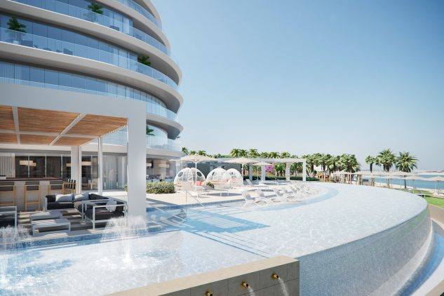 A luxury pool at the W Residences apartments in Pal Jumeirah, Dubai