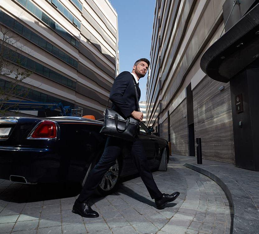 A man walks into his luxury apartment block in Dubai